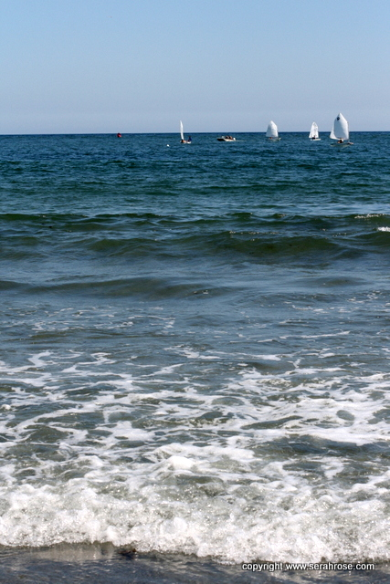 Atlantic ocean with tiny learning sailboats